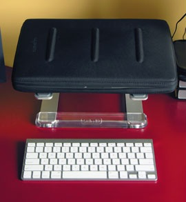 2007 Apple mini and slim Bluetooth Keyboard in front of Griffen iStand